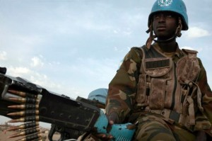 A Nigerian peacekeeping soldier from the United Nations-African Union Mission in Darfur (UNAMID) patrols in Otash IDP's camp in Nyla, southern Darfur