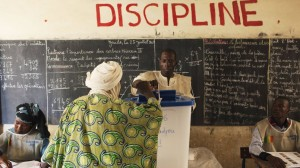 A man casts his vote during Mali's presidential election in Timbuktu