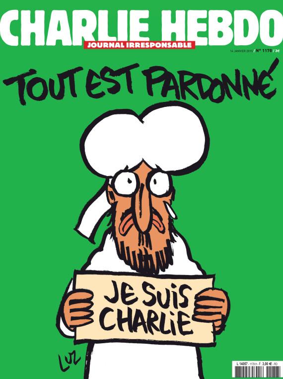 """La couverture du dernier Charlie Hebdo avec le prophète Mahomet représenté présentant le message """"je suis Charlie"""" et """"tout est pardonné"""""""
