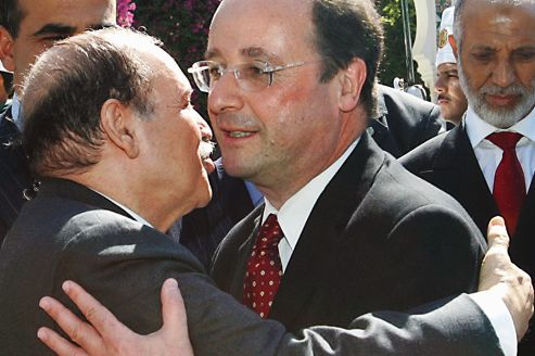 Algerian President Abdelaziz Bouteflika (L) greets French Socialist Party leader Francois Hollande (R) 08 July 2006 at the end of a meeting in Algiers as Algerian Prime Minister Abdelaziz Belkhadem (R) waits. Hollande is on a two-day official visit to Algeria.   AFP PHOTO/FAYEZ NURELDINE